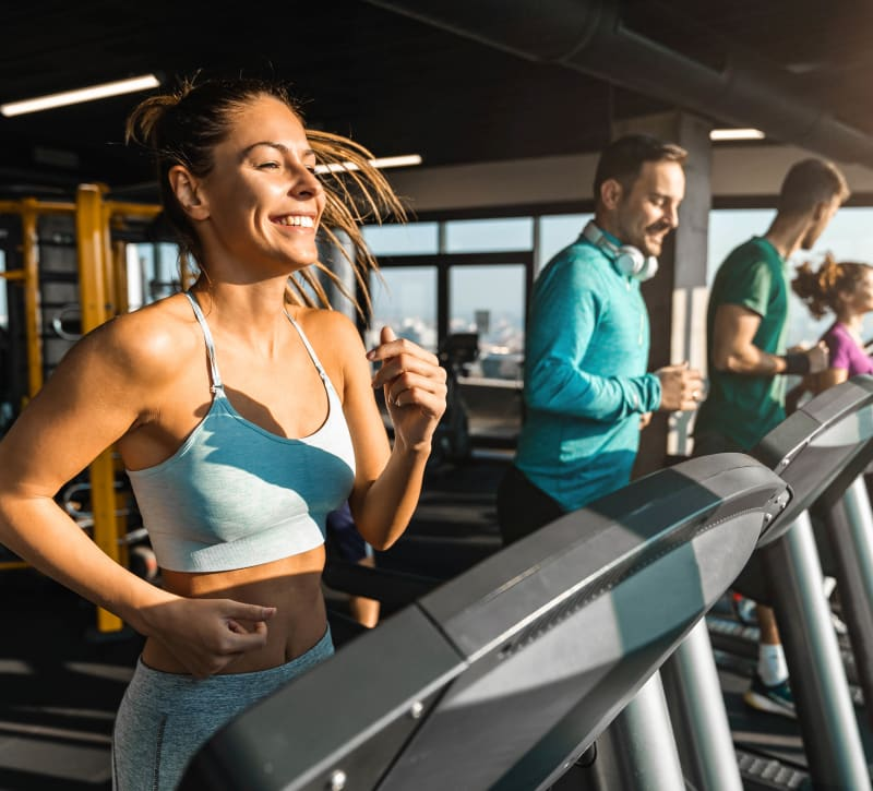 Residents staying in shape in the fitness center at Stonewood Apartments in Jacksonville, Florida