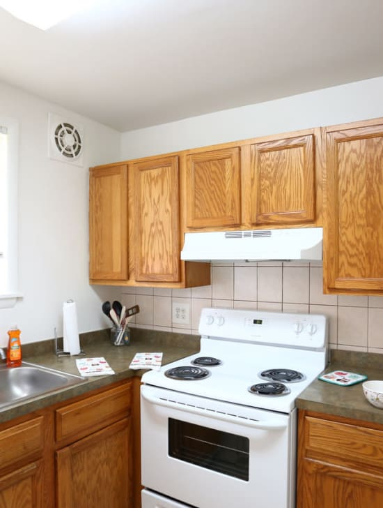 Spacious kitchen with white appliances at Bishop - Stratford Court Apartments in Stratford, New Jersey
