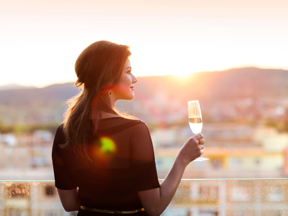 Resident drinking wine from the balcony at Mira Santi in Chandler, Arizona