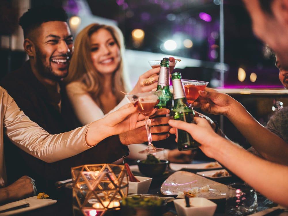 Friends celebrating over drinks near BB Living at Val Vista in Gilbert, Arizona
