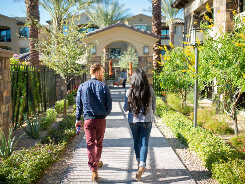 Residents walking the beautifully maintained grounds at San Valencia in Chandler, Arizona