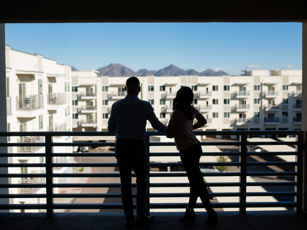 Resident enjoying the view from their private balcony at Slate Scottsdale in Phoenix, Arizona