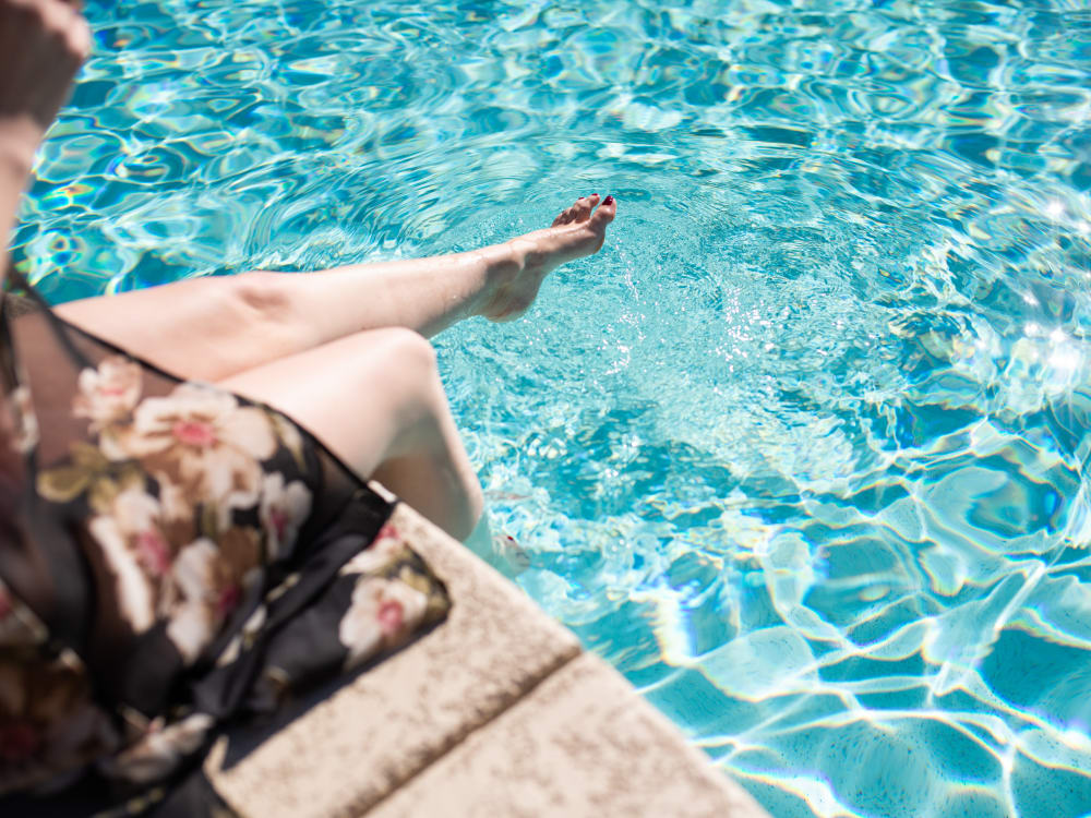 Resident dipping her toes in the pool at Shadow Hills at Lone Mountain in Las Vegas, Nevada