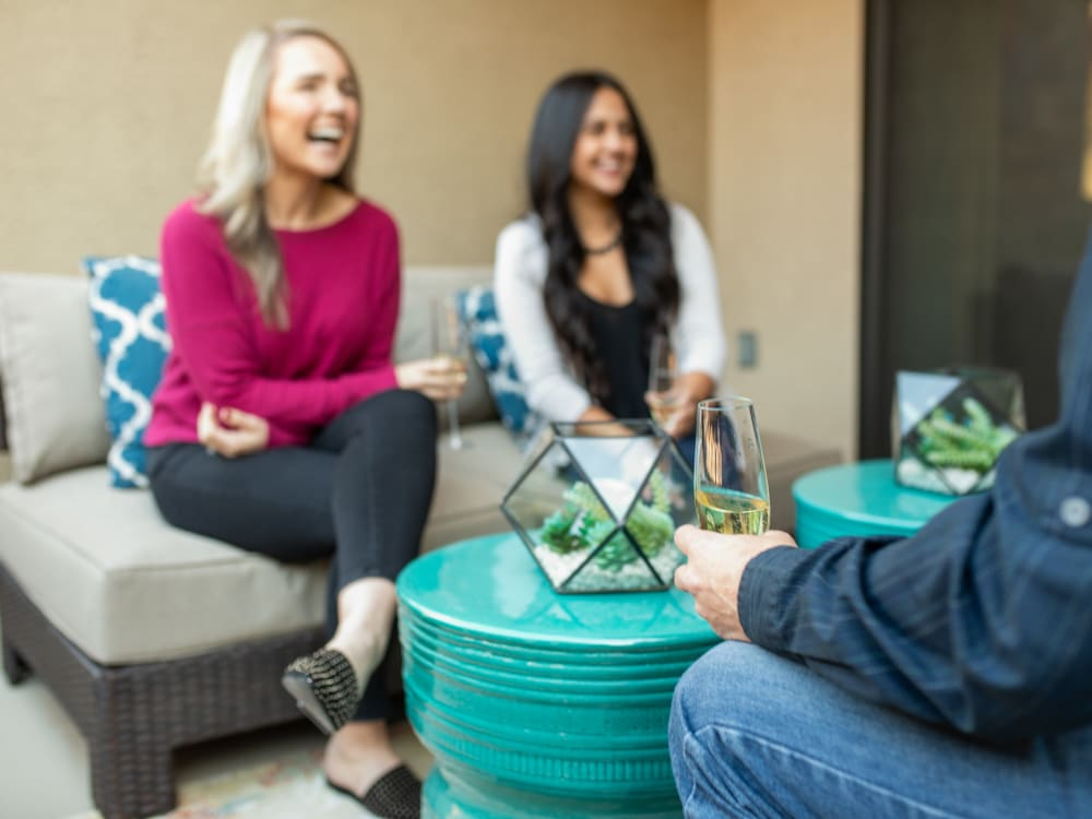 Residents friends enjoying drinks on their private patio at The Hyve in Tempe, Arizona