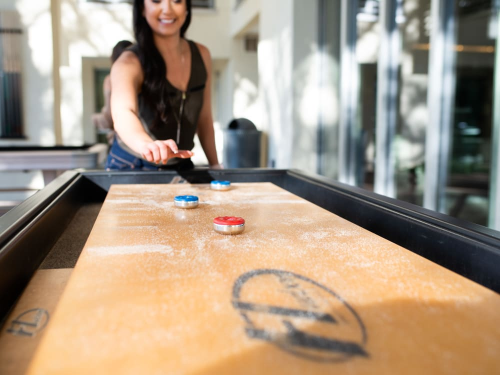 Residents playing shuffleboard in the clubhouse at The Hyve in Tempe, Arizona