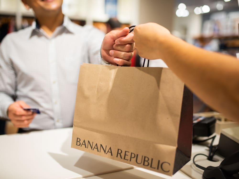 Resident finishing up some retail shopping near The Regents at Scottsdale in Scottsdale, Arizona