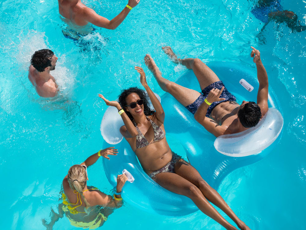 Residents enjoying a neighborhood pool party near BB Living at Val Vista in Gilbert, Arizona