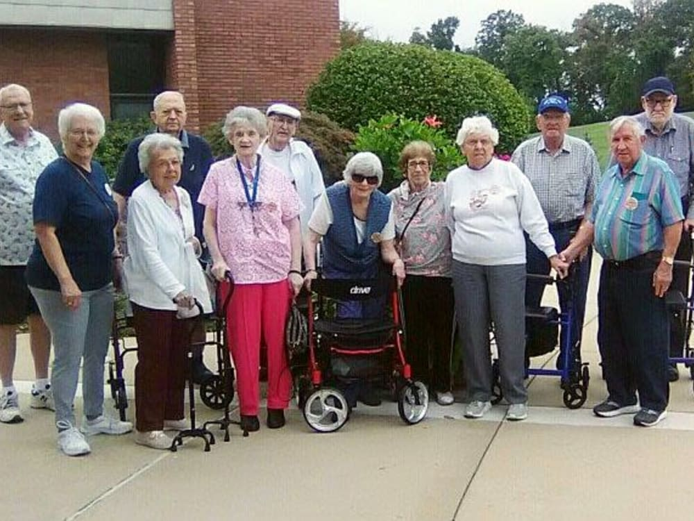 Group of residents pose for a picture at Garden Place Waterloo in Waterloo, Illinois.