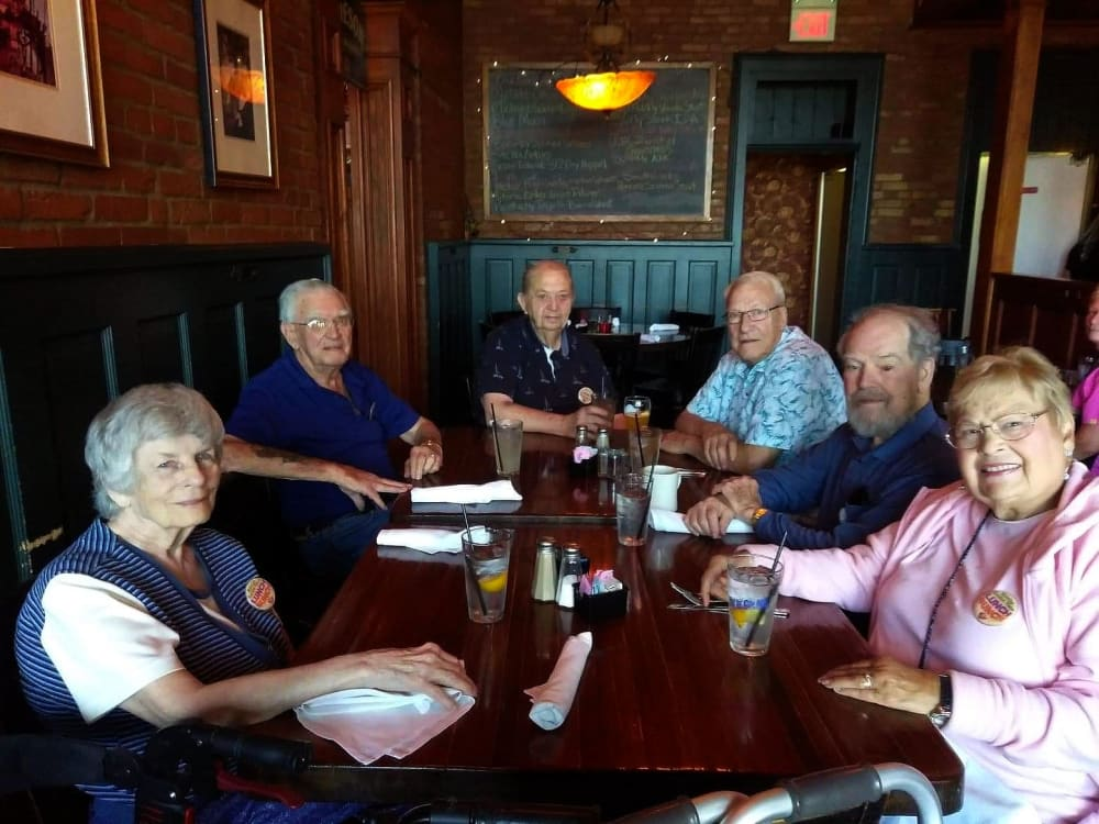 Several residents from Garden Place Waterloo enjoying a meal in Waterloo, Illinois