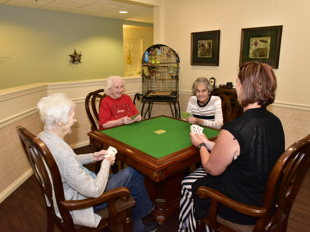 A few residents playing cards at Garden Place Columbia in Columbia, Illinois.