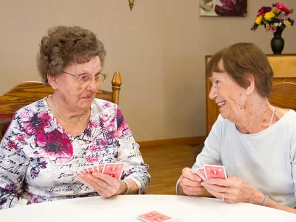 Two residents playing cards at Garden Place Red Bud in Red Bud, Illinois.