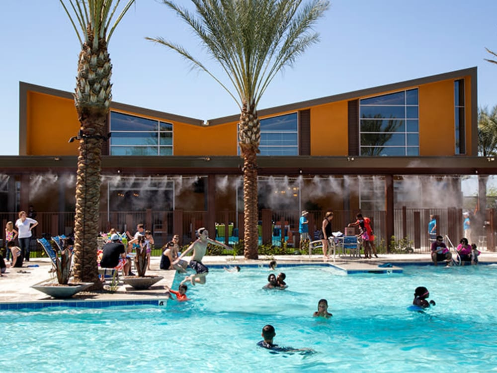 Children playing the community pool at BB Living at Eastmark in Mesa, Arizona