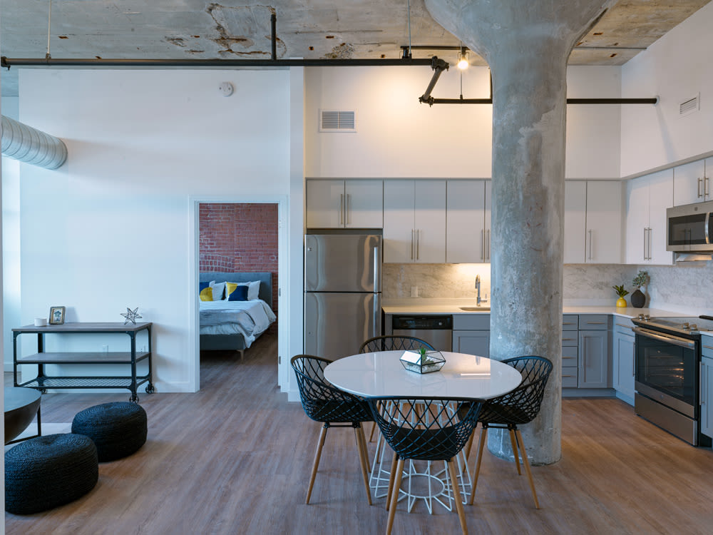 Kitchen with Exposed Concrete Beam at Montgomery Mill Apartments in Windsor Locks, CT