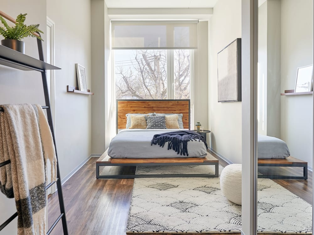 Bedroom with wood style flooring at The Link Evanston in Evanston, Illinois