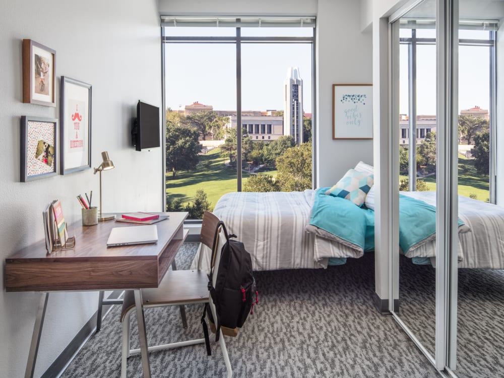 Bedroom with a study space at HERE Kansas in Lawrence, Kansas