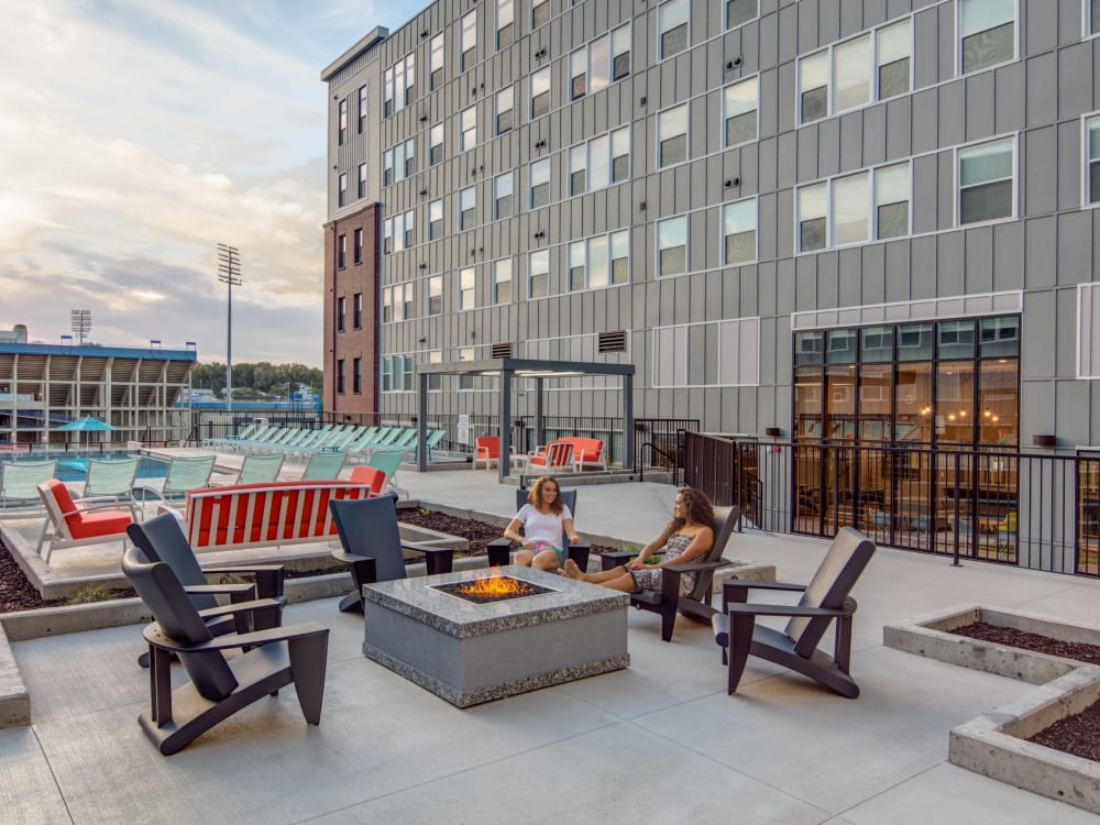 Outdoor lounge with a fireplace at HERE Kansas in Lawrence, Kansas