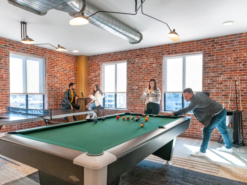 Game room with a pool table at The Link University City in Philadelphia, Pennsylvania
