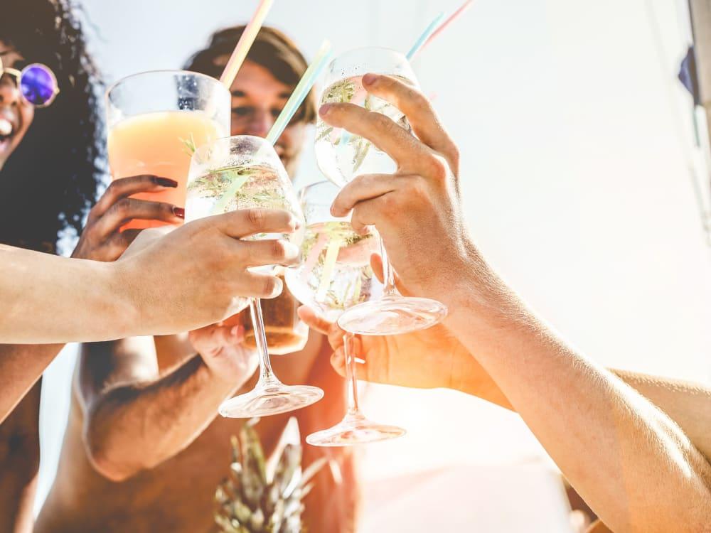 Friends enjoying drinks together near Gramercy Scottsdale in Scottsdale, Arizona