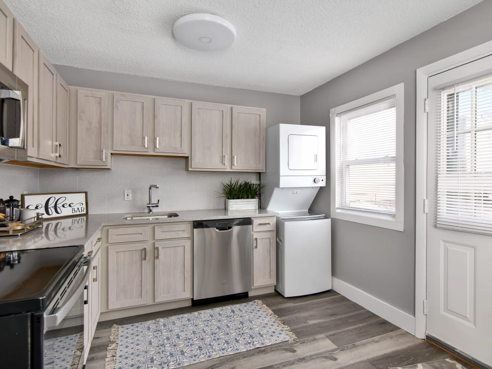 New kitchen cabinetry with laundry at Encore 99 in East Haven, Connecticut