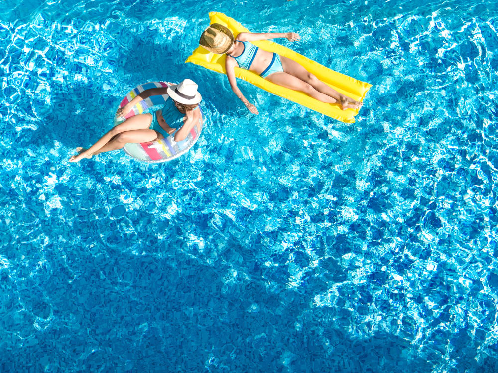 Two residents in the pool at TerraLane on Cotton in Surprise, Arizona