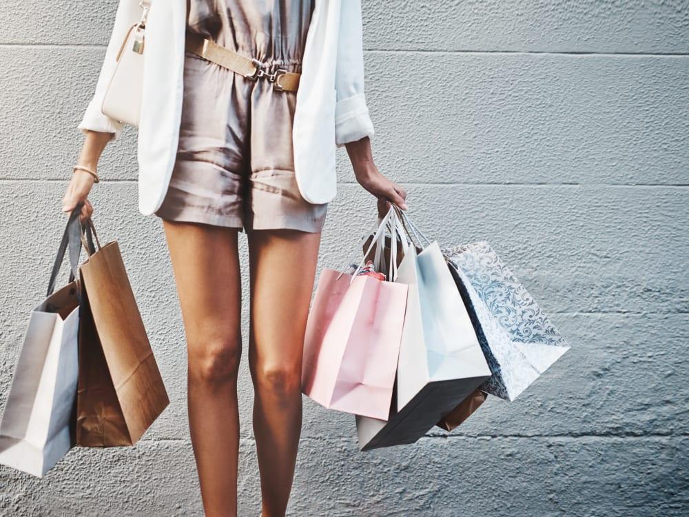 Woman with shopping bags near Cyrene at South Mountain in Phoenix, Arizona