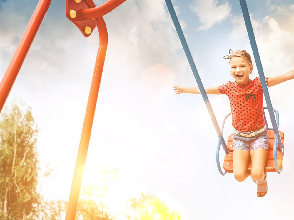 Kid on a swing at Cyrene at Estrella in Goodyear, Arizona