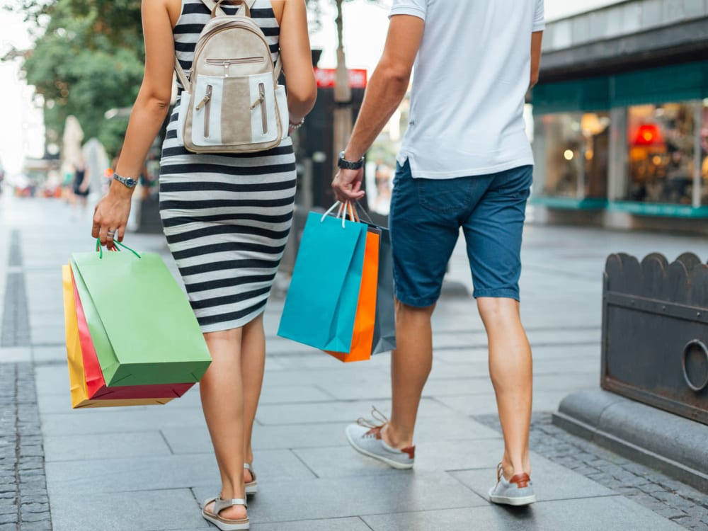 Happy residents walking around the neighborhood shops at Tavalo at Cadence in Mesa, Arizona