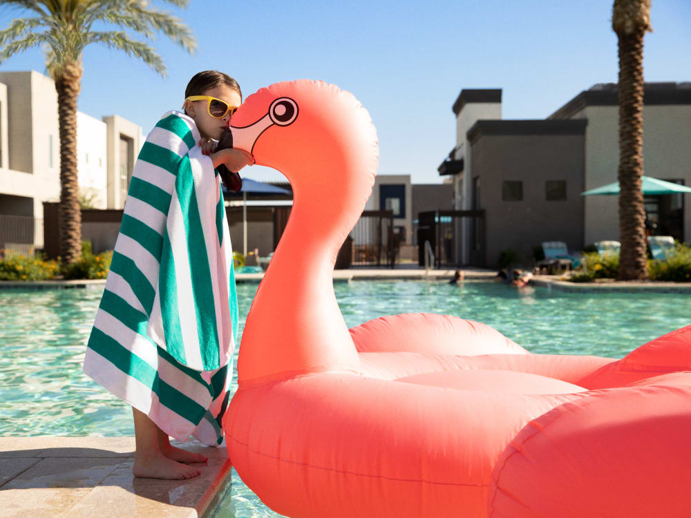Kid with an inflatable at the pool at BB Living at Eastmark in Mesa, Arizona