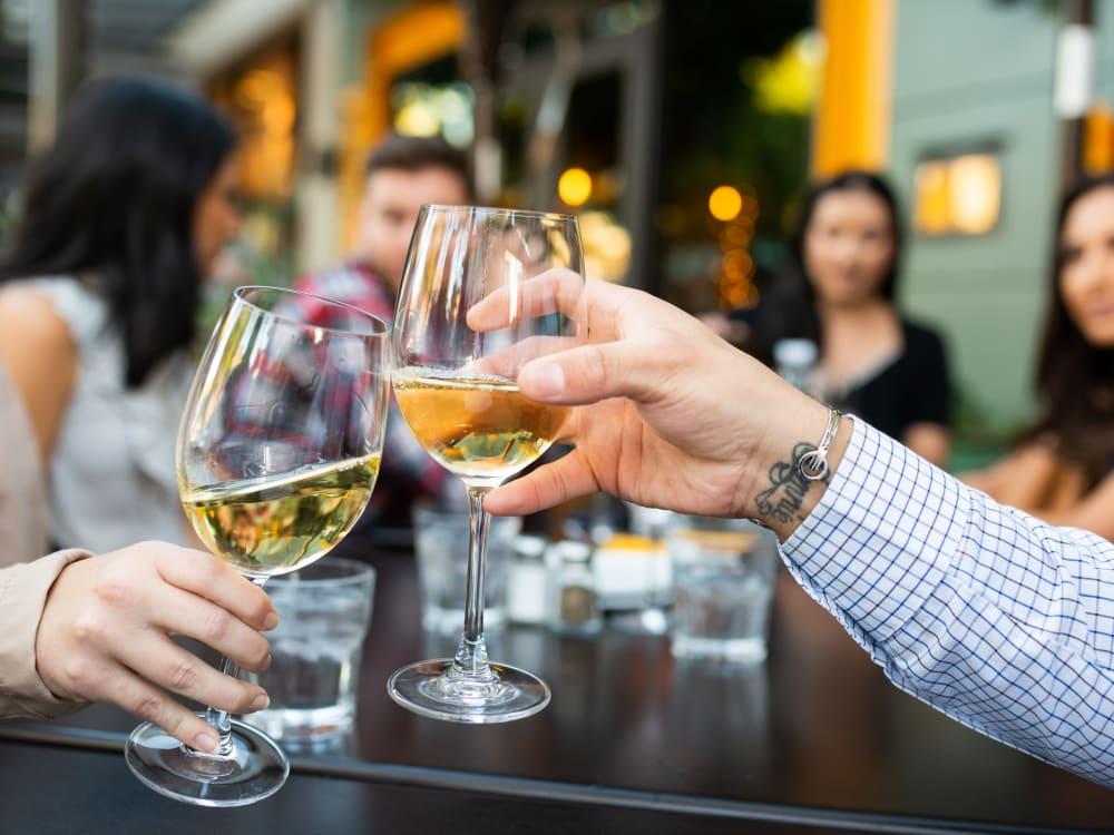 Friends drinking wine near Las Casas at Windrose in Litchfield Park, Arizona