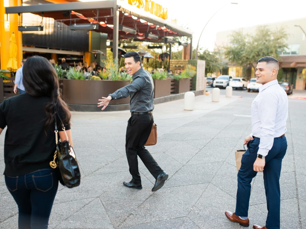 People with shopping bags near Gramercy Scottsdale in Scottsdale, Arizona