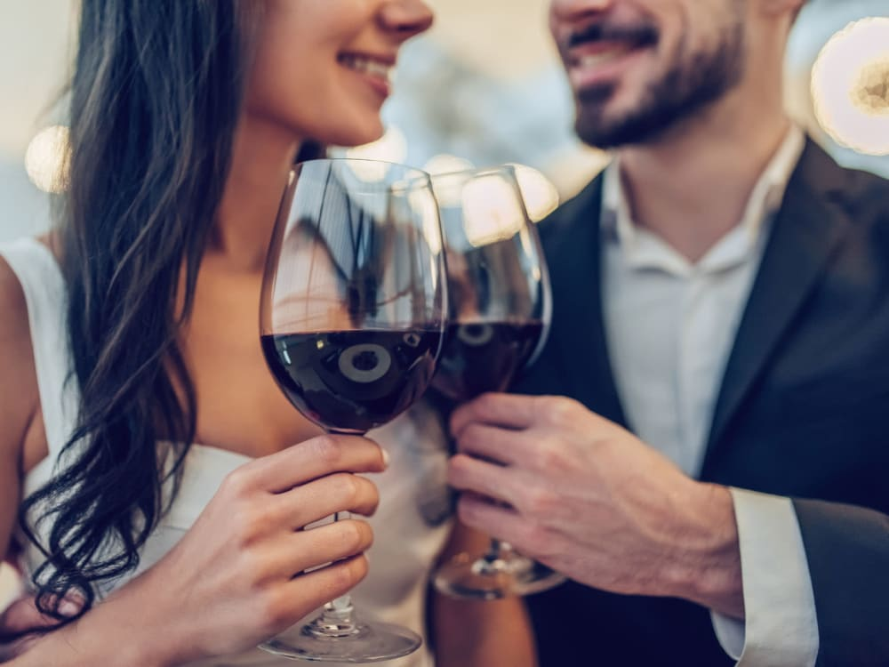 Couple dressed up for a night out enjoying some fine wine near Peralta Vista in Mesa, Arizona