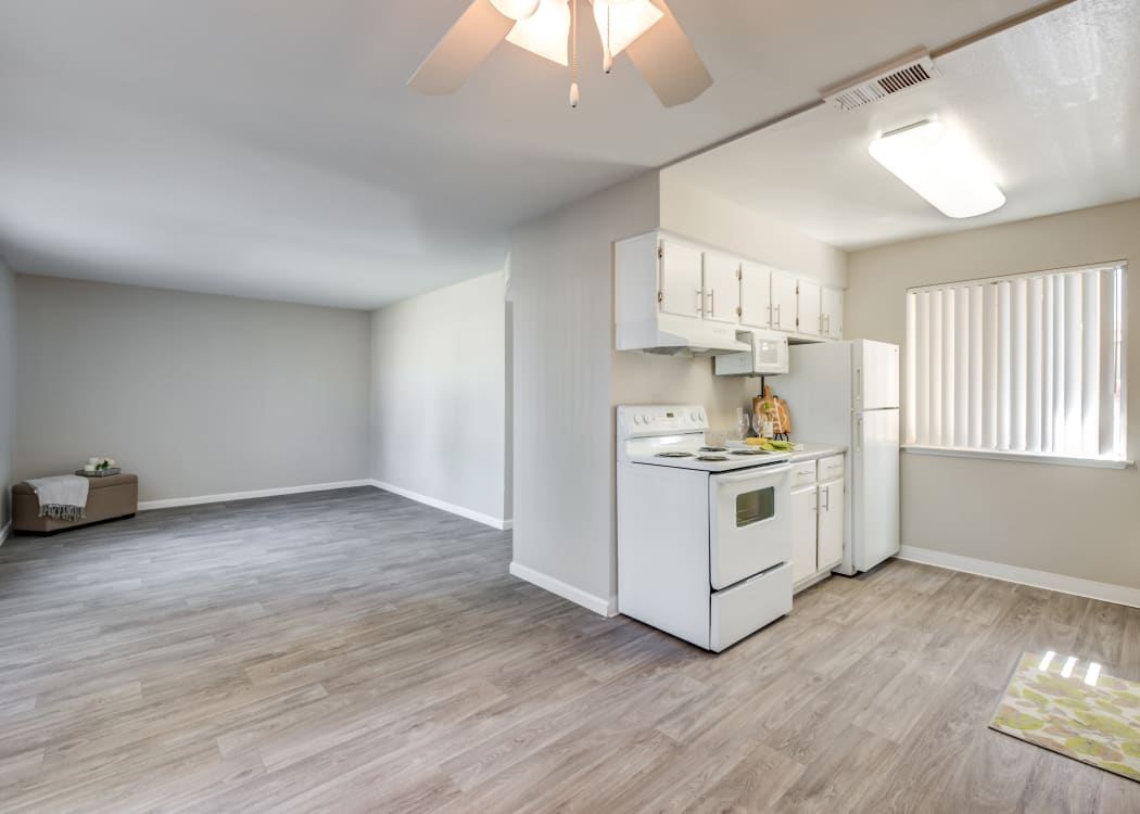 Kitchen with white cabinets at Granada Villas Apartment Homes in Lancaster, California