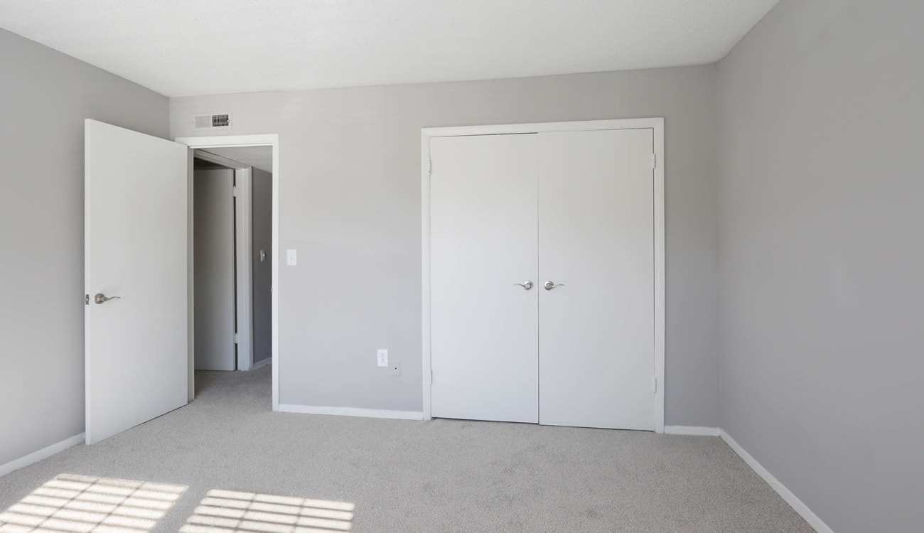 Closet with double doors in an apartment's bedroom at Alturas Embry Hills in Doraville, Georgia