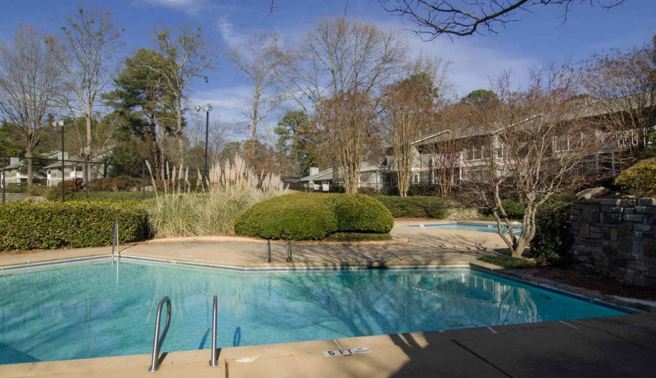 Resort-style outdoor swimming pool at Reserve at Twin Oaks in Clarkston, Georgia