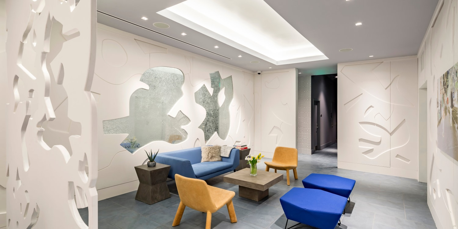 AdMo Heights reception area with blue chairs in Washington, District of Columbia