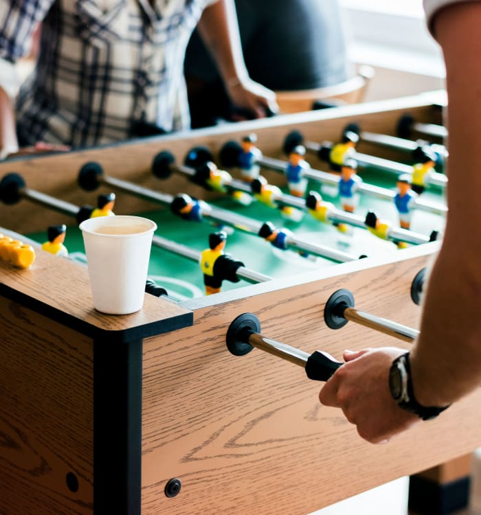 Residents playing foosball at Montecito Apartments at Carlsbad in Carlsbad, CA