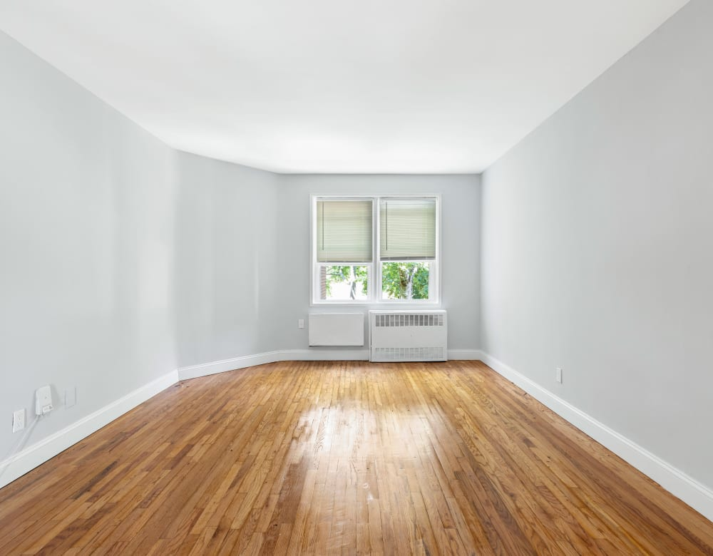 Spacious living room with hardwood flooring at Bergen Apartments in Freeport, New York