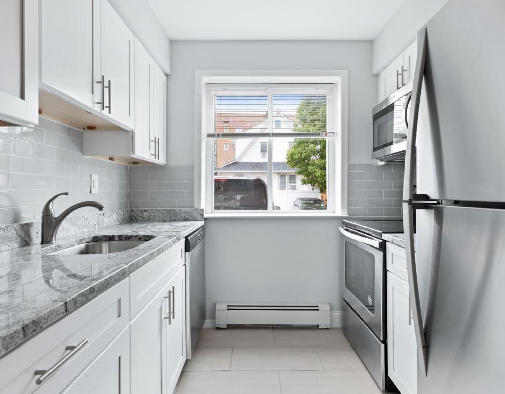 Sleek modern kitchen at Grove Gardens in Freeport, New York