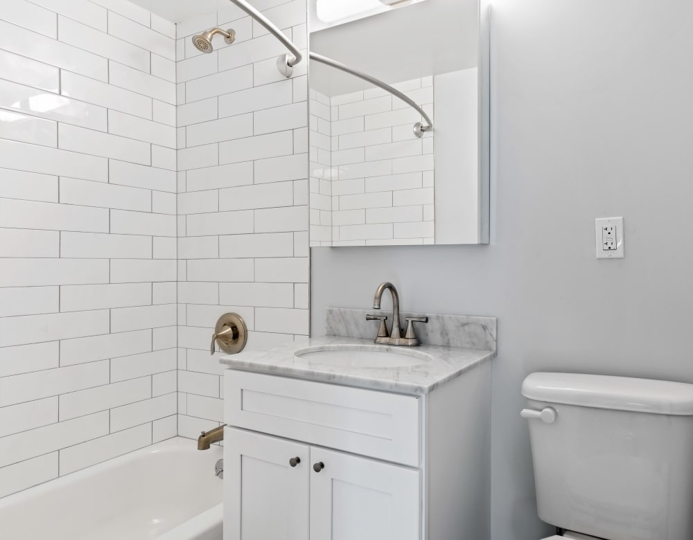 Clean, bright bathroom at Grove Gardens in Freeport, New York