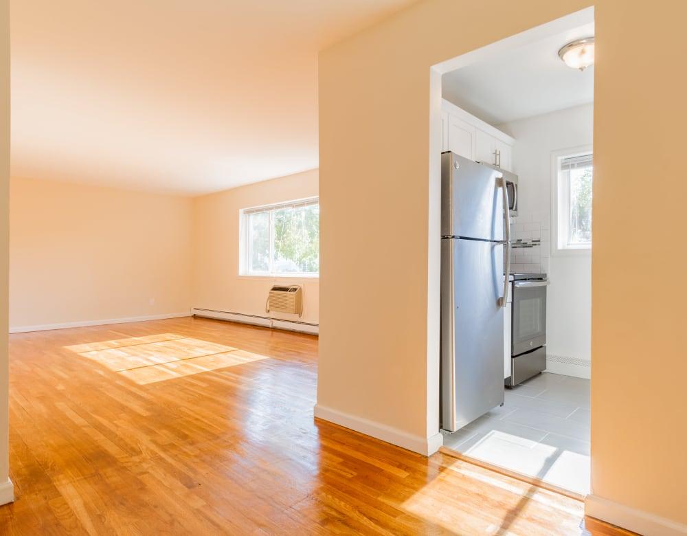 Hardwood flooring in main living area at Brixton Lane in Levittown, New York
