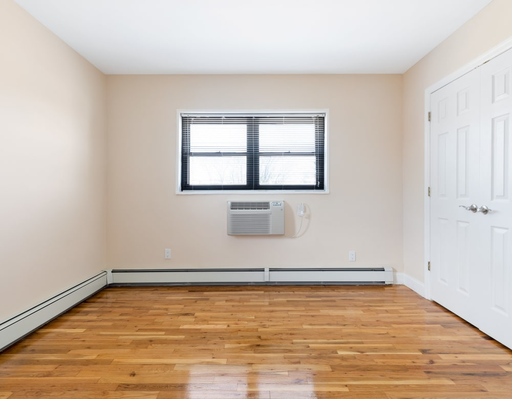 Bedroom wit hardwood flooring at Eagle Rock Apartments at Hicksville in Hicksville, New York