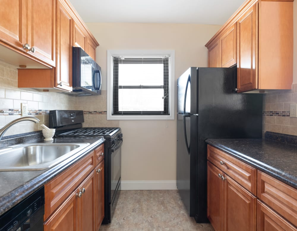 Kitchen with a window at Eagle Rock Apartments at Hicksville in Hicksville, New York