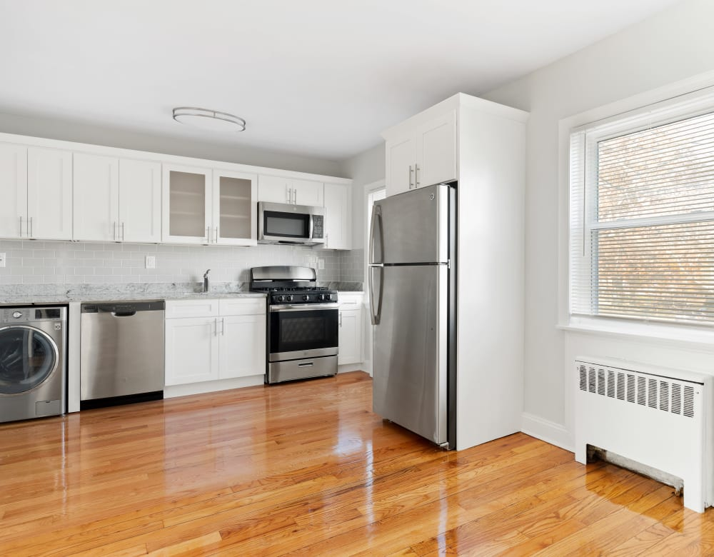 Kitchen with hardwood flooring at Eagle Rock Apartments at Huntington Station in Huntington Station, New York