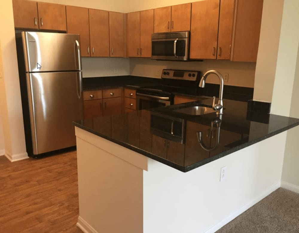 Modern appliances and kitchen cabinetry at Westville Village Apartments in New Haven, Connecticut
