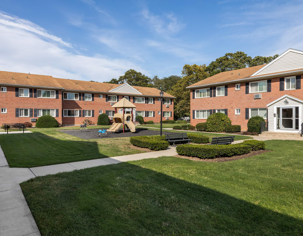 Expansive green courtyards at Mid Island Apartments in Bay Shore, New York