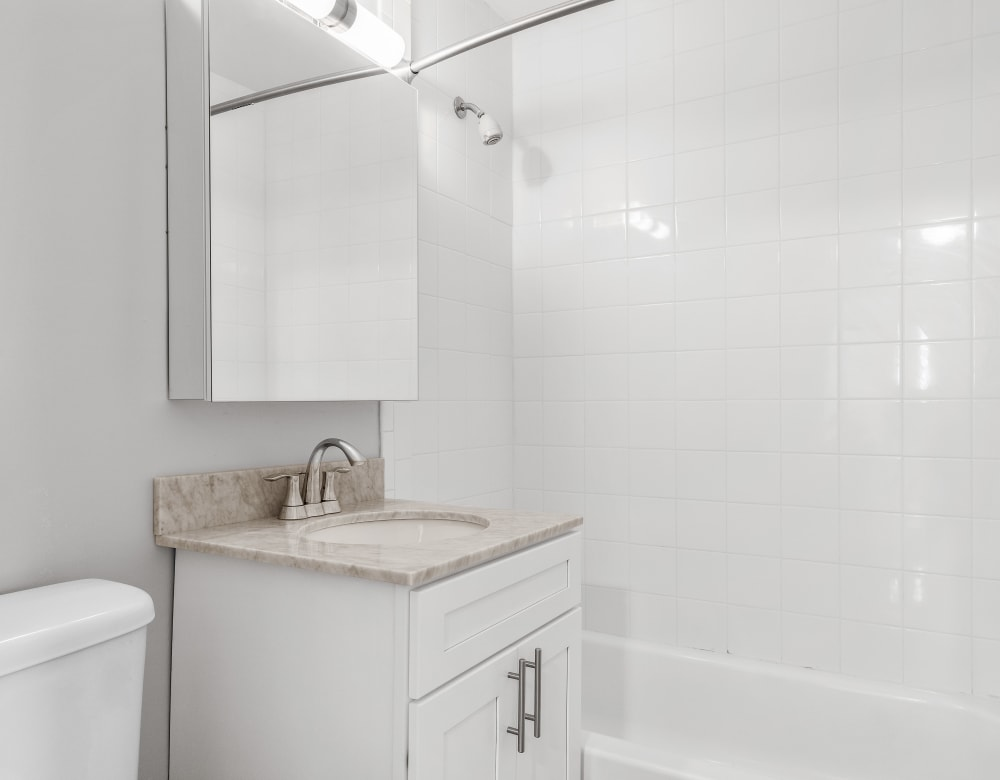 Bright bathrooms at Mid Island Apartments in Bay Shore, New York