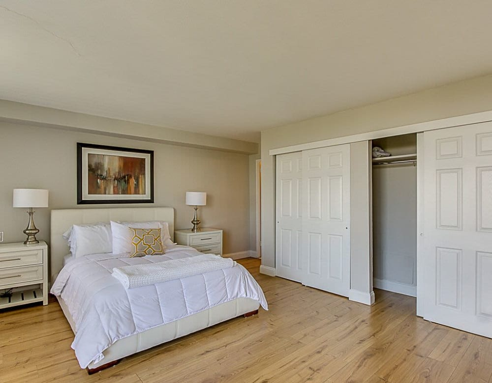 Spacious master bedroom with hardwood flooring and large closets at Chestnut Hill Tower in Philadelphia, Pennsylvania