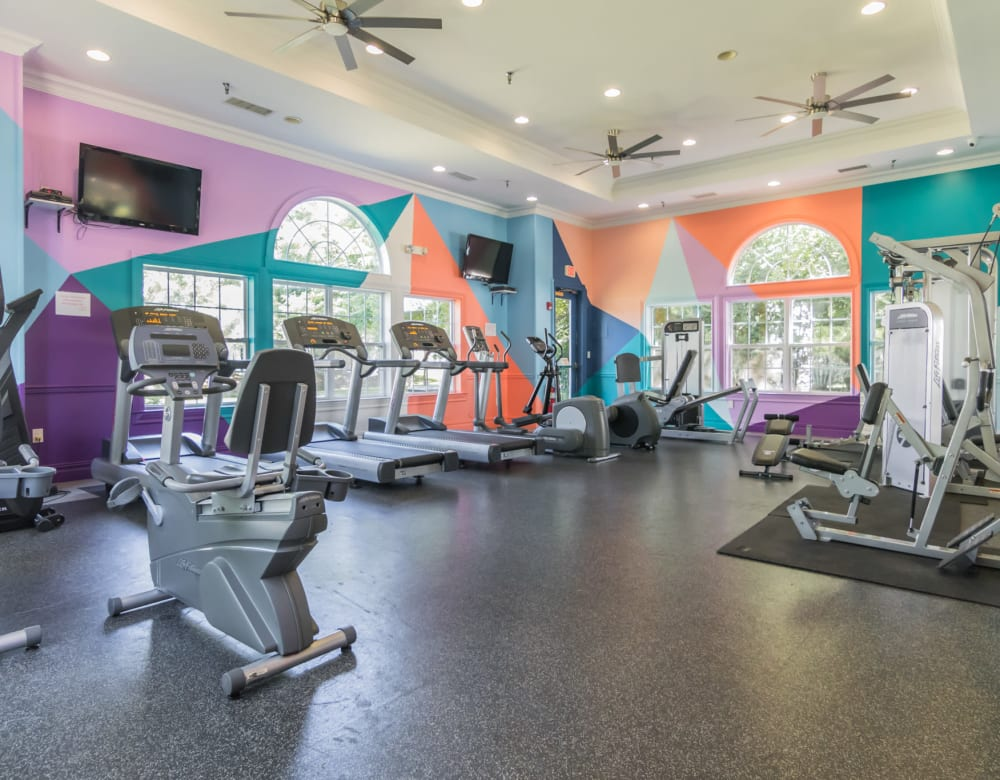 Modern workout equipment featuring exercise bikes treadmills and ellipticals  at Eagle Rock Apartments at Freehold in Freehold, New Jersey