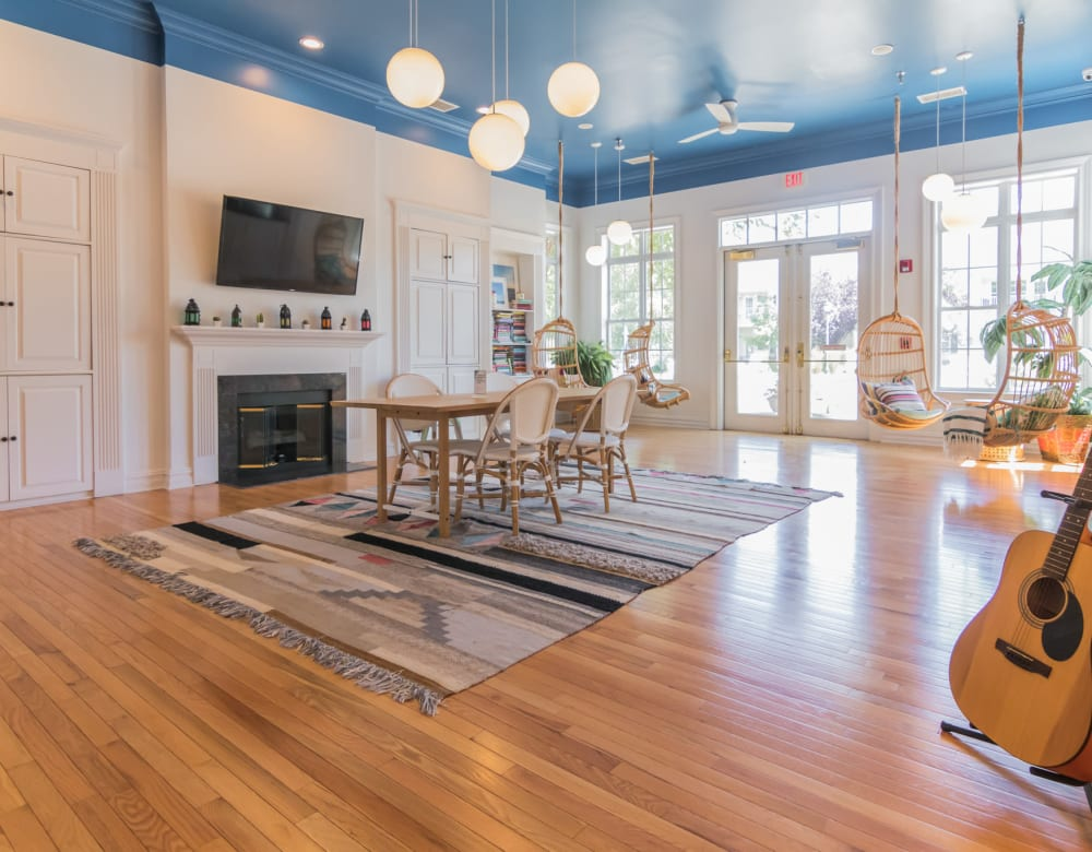 Clubhouse interior with hardwood floors and abundant natural light from large windows at Eagle Rock Apartments at Freehold in Freehold, New Jersey