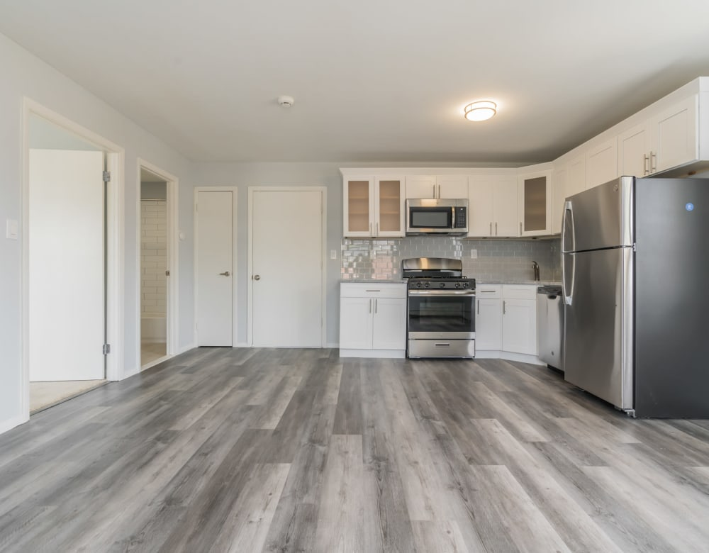 A large kitchen with hardwood floor at Bunt Commons I in Lindenhurst, New York